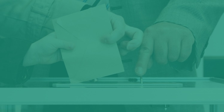 Giving feedback by putting comments in an envelope and placing it in a ballot box